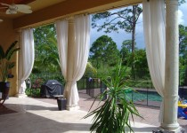 These elegant outdoor curtains were made with grommets and installed on custom made iron rods.