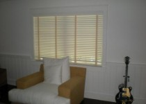 Classic wood blinds made with a decorative tape to add some style.  2-inch real wood louvers.