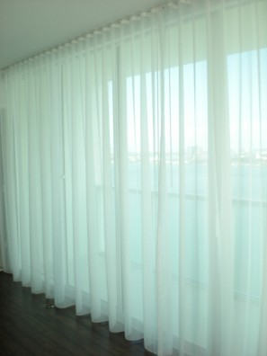 Custom fabricated ripple fold sheer curtains installed in Key Biscayne, FL.